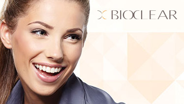 Smiling woman and BioClear logo